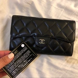 CHANEL long flap wallet with silver hardware